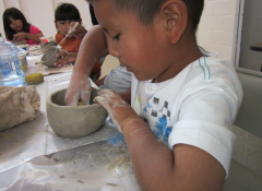Young child working with ceramics