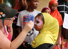 Participants at a Mixed Blood health fair get their face painted