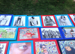 A collage of printed photos on green grass