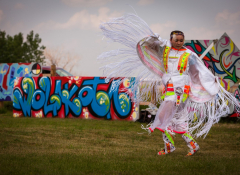 A Lakota teen dances at Cheyenne River Youth Project's inaugural RedCan graffiti jam in 2015. Photo credit Richard Steinberger.