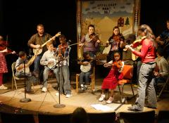 Schoolchildren perform with Appalshop staff in Whitesburg, Kentucky. Photo by Mimi Pickering.