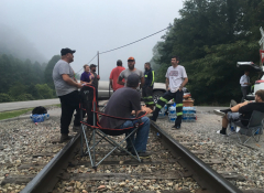 Image of a film crew on an abandoned train track.