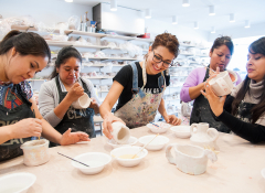Five women in a pottery class