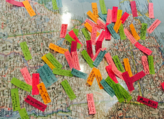 Close-up street map with various colorful papers on it