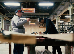 Two men working in the coalfield development factory
