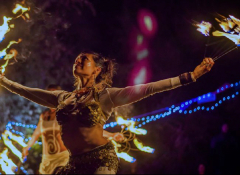 Tanya Blacklight performing with fire at night