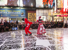Two people performing in a Street Opera in Times Square