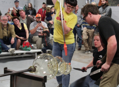TARworks Glass staff and interns work on free glassblowing demonstrations.