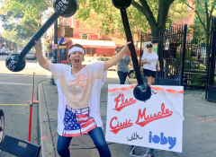 "Image of a woman holding two plastic dumb bells with a tshirt that says ""Civic-Muscle Tee."""