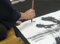 A hand painting with a brush and black ink.