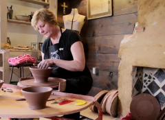 Image of Renée Margocee at the pottery wheel