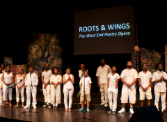 A group of performers on a stage.