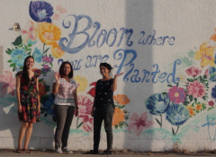 Artist Collective, Las Imaginistas, standing in front of local street art by Josue Ramirez (RAW) in Downtown Brownsville, Texas.