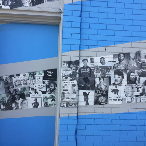 Bright blue mural with black and white photos along the wall