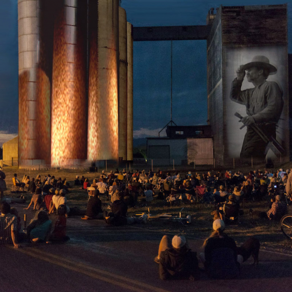 Images projected on a mill while an audience watches