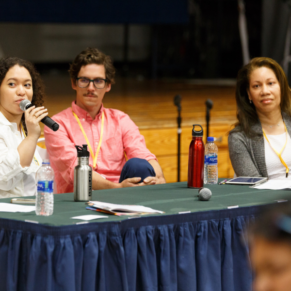Leila Tamari, Sean Starowitz, and Hope Knight sit behind a table