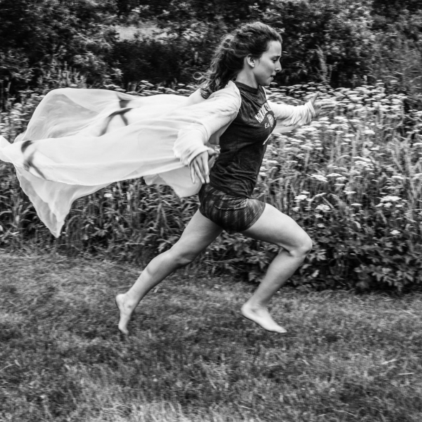 Black and White photo of dancer in a field.