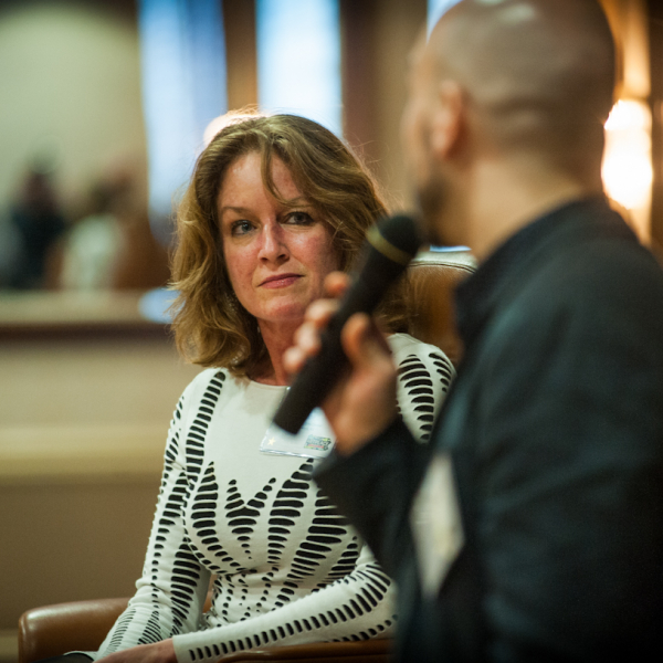 Image of a woman listening to a man speak