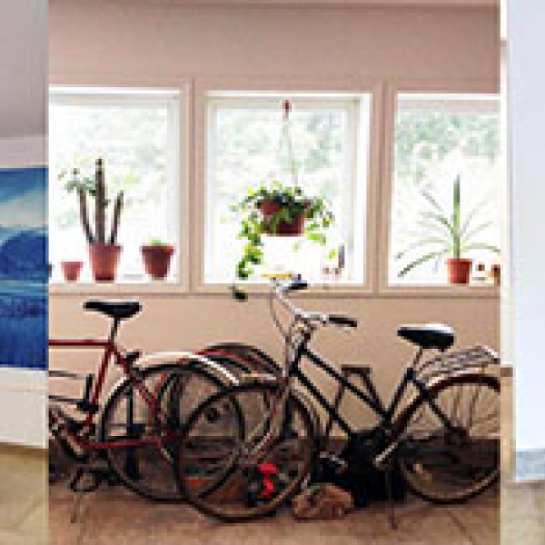 Image of a room with a group of bicycles together.
