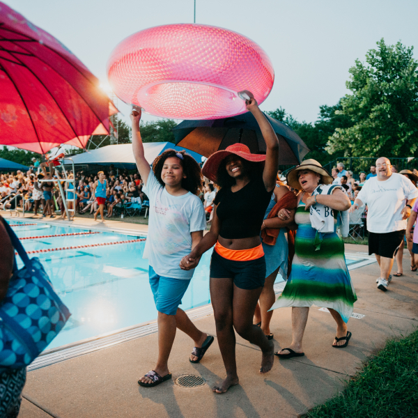 Featuring over 50 neighborhood residents, Dove Springs Swims (2018) began with a celebratory community paseo around the pool. Photo by Jonica Moore.