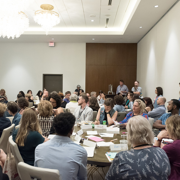 Three round tables filled with people at the ArtPlace Summit