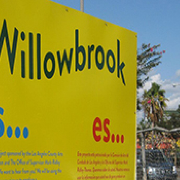 A yellow sign that says Willowbrook is...
