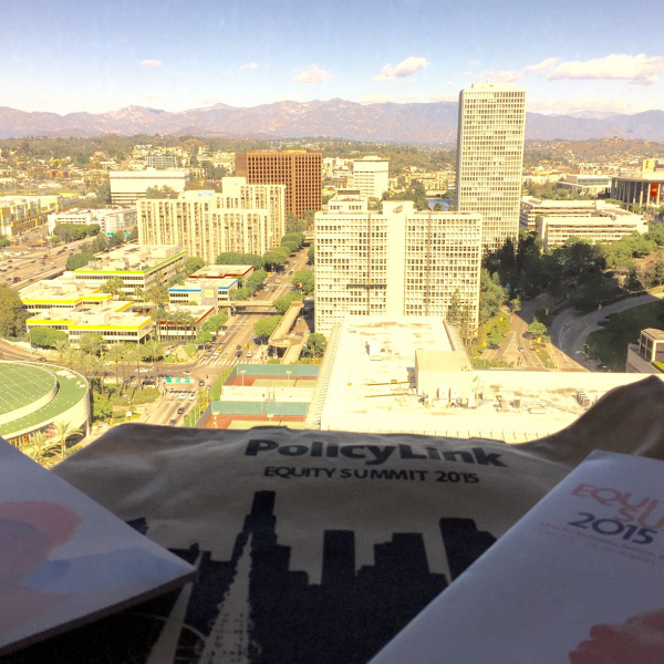 Landscape image of Los Angeles with papers on a desk