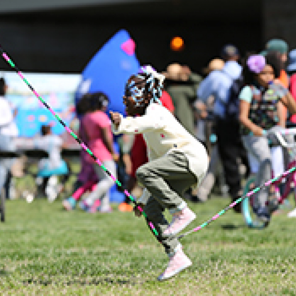 A young girl playing jump rope